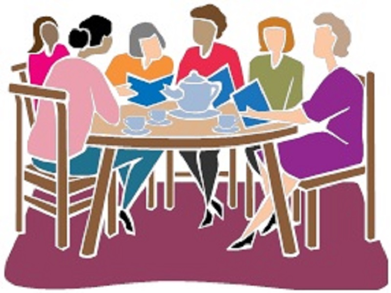 women at a table discussing books
